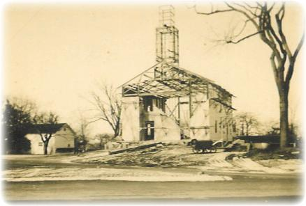The current meetinghouse was under construction in 1936 after the fire in April, 1935.